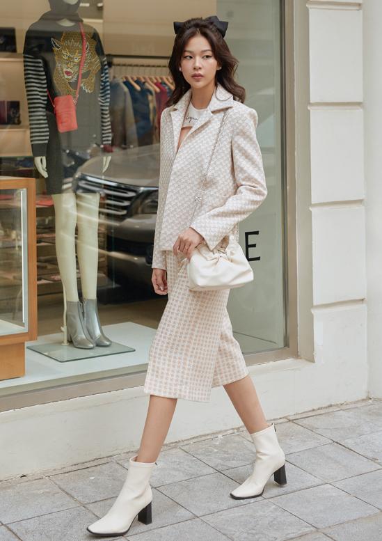 Áo kiểu vest kết hợp quần culottes và bốt cổ ngắn tạo phong cách trẻ trung, cá tính cho người đẹp The Face 2016.