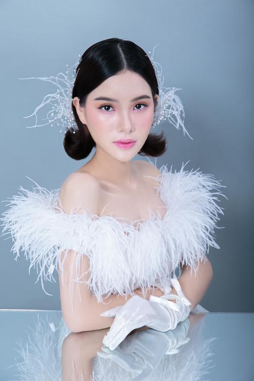 Bộ ảnh được thực hiện bởi makeup & hair: Hồ Thiên Tuấn, photo: KD Tran, wedding dress: HuuLoiCao, model: Phung My Le