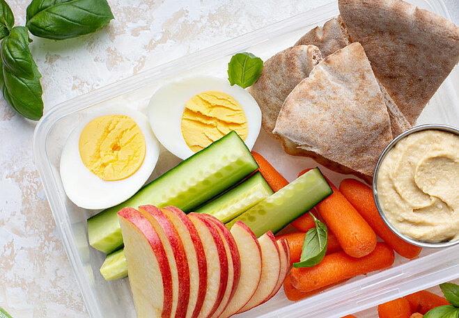 A healthy afternoon snack keeps you from getting too hungry, leading to overeating at dinner.